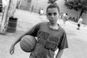 A boy takes a break from a basketball game in Brooklyn, New York