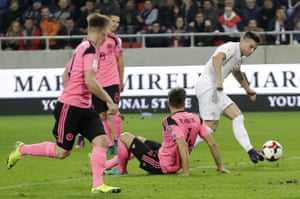 Slovakia's Robert Mak, right, scores his side's second goal against Scotland.
