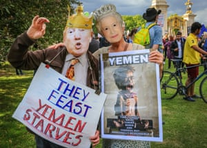 Protestors outside Buckingham Palace using placards, banners, musical instruments and their voices against  the visit of President Trump