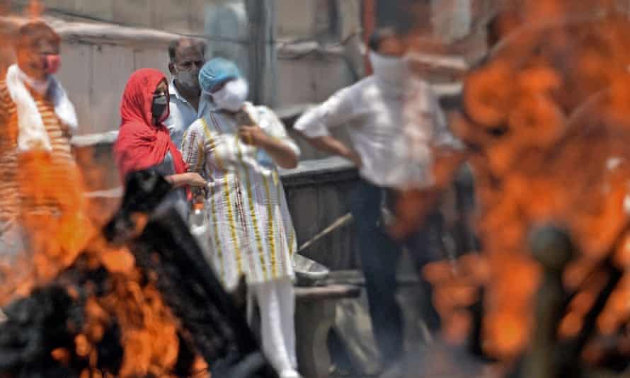 Pyres burn at a crematorium in Delhi