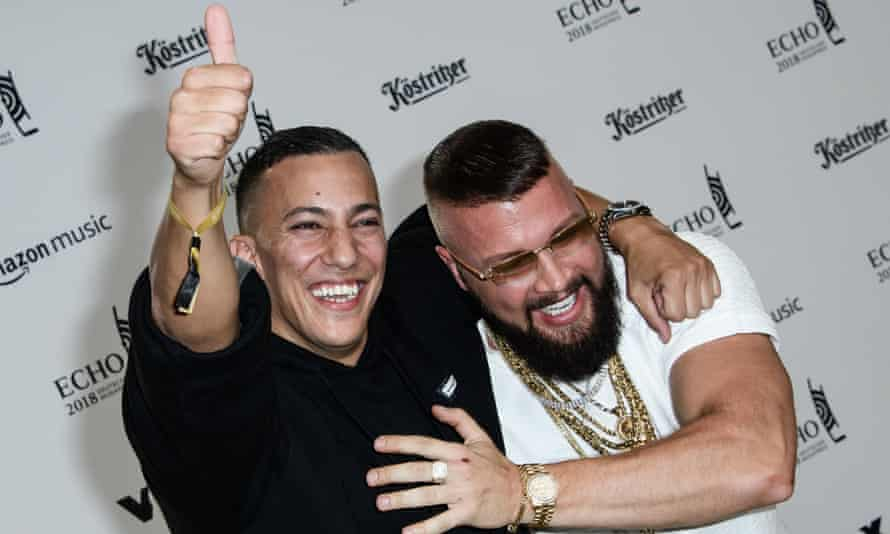 German rappers Farid Bang (left) Kollegah pose on the red carpet at the Echo 2018 music awards in Berlin.