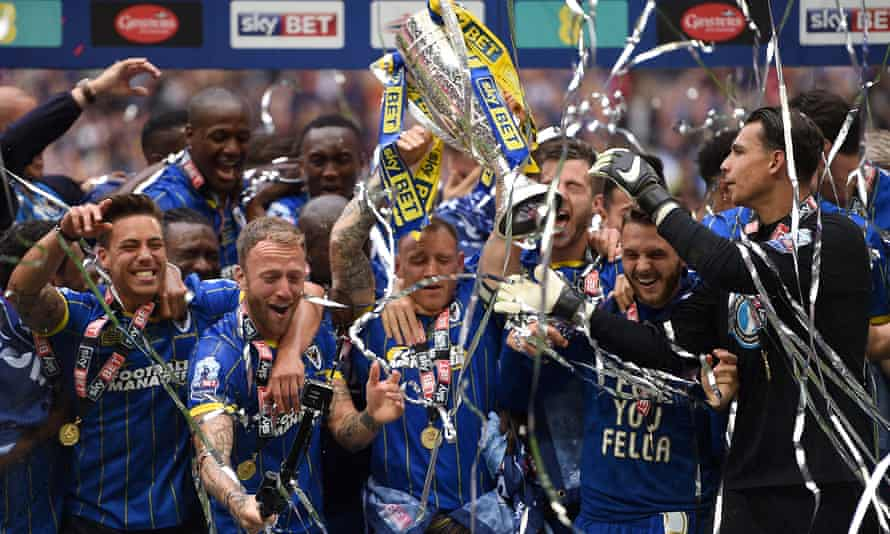 AFC Wimbledon players celebrate winning promotion to League One