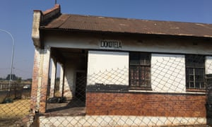 "A sign advertising ""Dokotela Maxwell"" on the side of the former clinic in Putfontein."