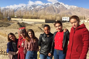 Tajik women who are optimistic about the region's redevelopment.