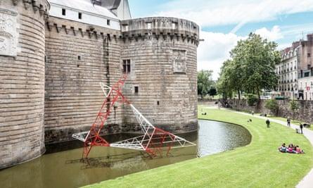 Undercurrent: a 'fallen' electricity pylon in the moat of a 14th-century Nantes castle.