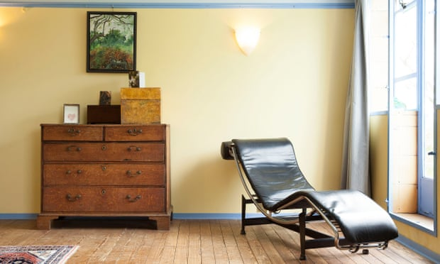 Period touches: a replica Corbusier recliner in a bedroom.