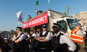 Demonstrators on top of a truck were surrounded by police as the blockade at Waterloo Bridge continues.