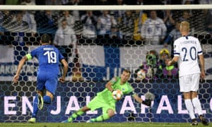 Italy's Jorginho (out of picture) slots his penalty home for the winner against Finland.