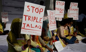 Activists hold placards during a protest against 'triple talaq' in New Delhi, India