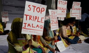 Social activists hold placards during a protest in New Delhi against the triple talaq law