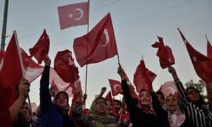 Women hold Turkish flags