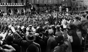 Nazi troops march through Vienna in 1938.