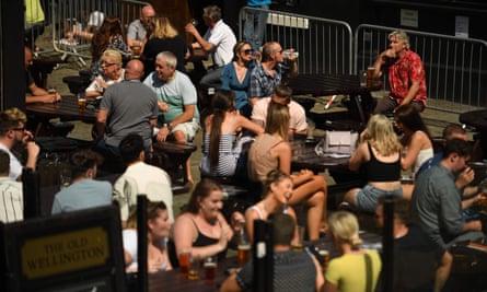 Customers in a pub garden in Manchester last week.