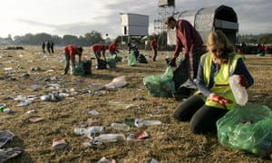 Volunteers collecting rubbish from Glastonbury's Pyramid Stage field.
