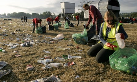 Volunteers collect rubbish from the festival site