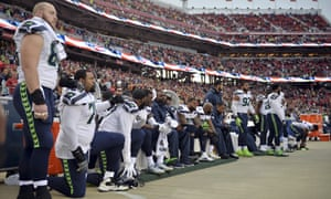 Seattle Seahawks sit and kneel during the national anthem in November 2017