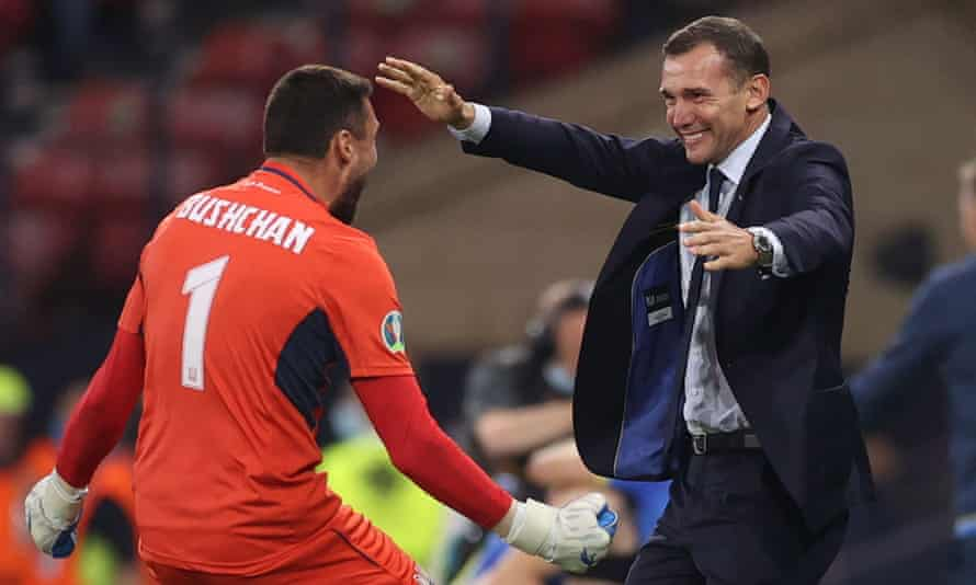 Ukraine's coach Andriy Shevchenko celebrates the Euro 2020 last-16 win over Sweden with the goalkeeper Georgiy Bushchan.