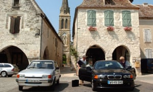 A British couple park their car in Eymet, in the Dordogne region, southwest France