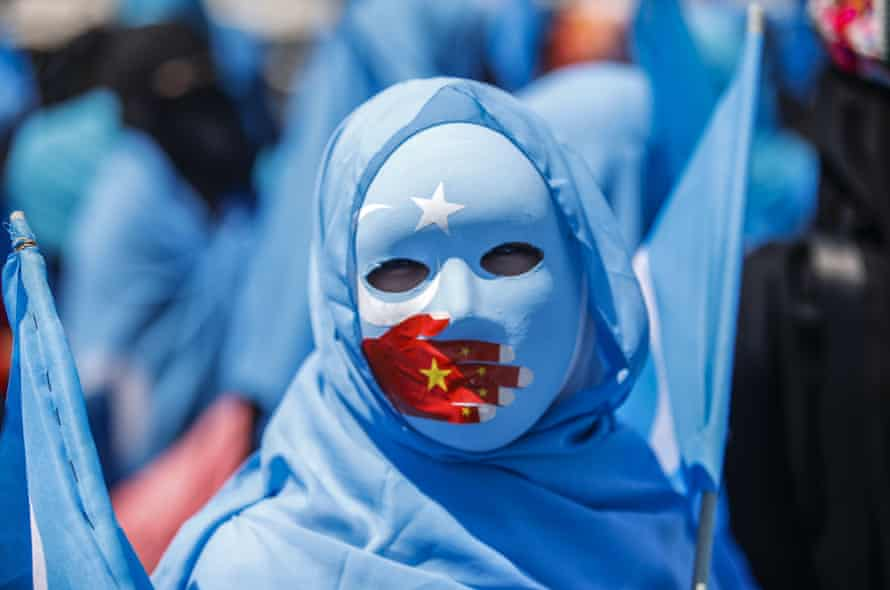 Supporters of the Uighur minority denounce China's treatment of ethnic Uighur Muslims during a rally in Istanbul, Turkey.