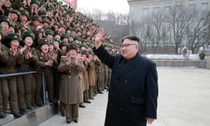 The North Korean leader, Kim Jong-un, waves as he inspects a Korean People's Army unit at an undisclosed location.