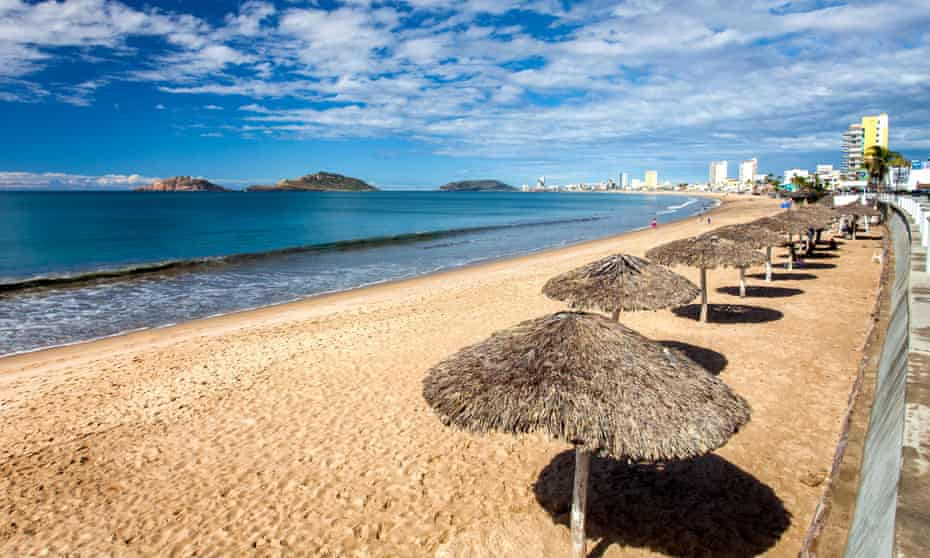 Palapas line the boardwalk in the Pacific resort city of Mazatlan, Sinaloa, Mexico.