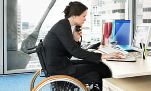 Disabled woman working at desk
