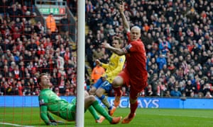 Martin Skrtel celebrates after scoring the first goal in Liverpool's 5-1 win in February 2014, when Arsenal had arrived at Anfield leading the Premier League.