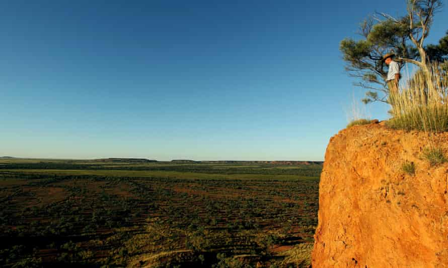 A man at a cliff edge in outback Australia
