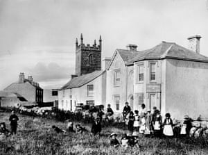 Locals gather around the 'First Hotel in England' at Sennen Cove.
