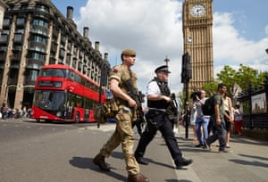 The army join armed police in patrolling the area around parliament, Westminster, London