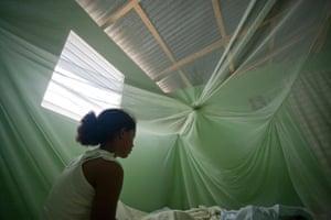 Alicia sits on her bed at home in Las Matas de Farfán, Dominican Republic, in June, 2009