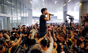 Hong Kong protests: pro-democracy activist Joshua Wong, pictured addressing protesters, was arrested by police on Friday.