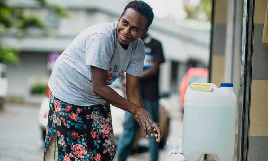 a person on vanuatu washing their hands to protect against coronavirus