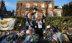 Tributes of flowers, photographs and candles outside George Michael's home in Highgate, north London