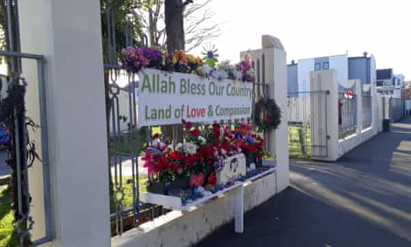 A welcoming sign stands outside al Noor mosque in Christchurch, New Zealand.