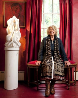 The new stone age: Helaine Blumenfeld in the dining room of her Cambridge home. It's painted red to match the self-portrait by her father-in-law.