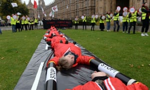 Activists from Reclaim the Power and Plane Stupid block a mock runway on College Green outside the Houses of Parliament