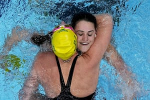 Kaylee McKeown is congratulated by teammate Emily Seebohm after winning the final of the women's 100m backstroke