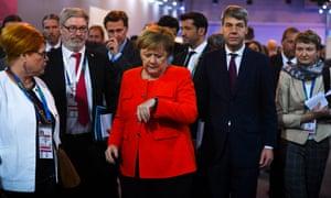Angela Merkel checking watch