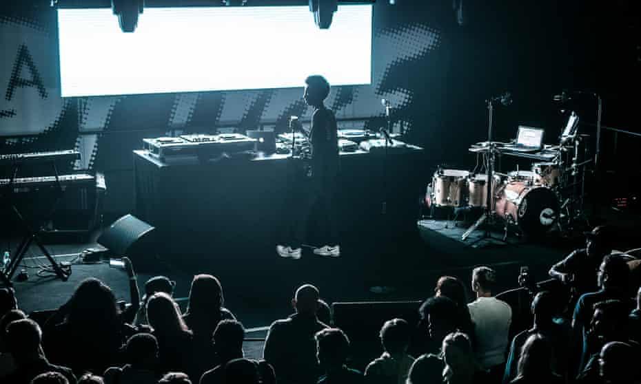 In La Place to be … rapper on stage at La Place, Paris's' hip-hop cultural centre.