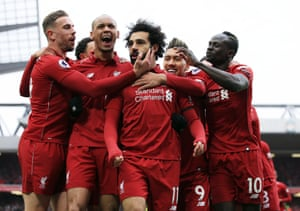 Mohamed Salah celebrates scoring a screamer into the top corner from 25 yards to make it 2-0 Liverpool.
