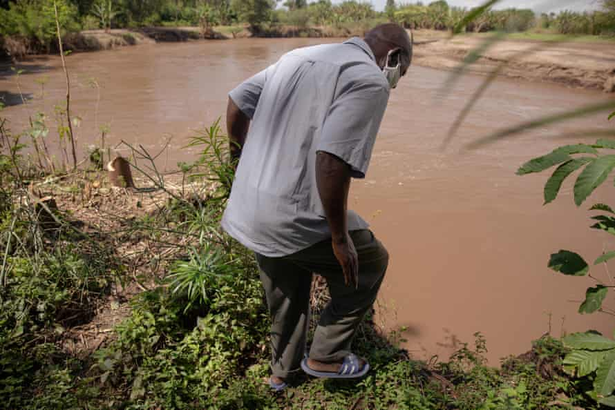 Joseph Oyamo on the eroded banks of a river in Kisumu county.