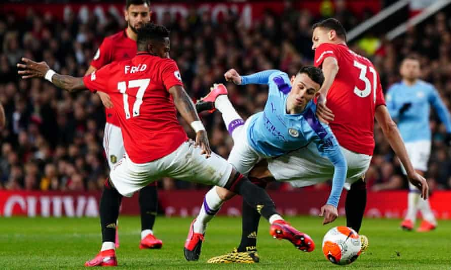 Manchester United take on Manchester City, on 8 March. The Premier League hopes to resume in June.