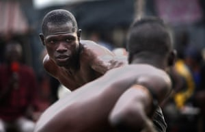 Lagos, NigeriaBoxers compete in a traditional combat sport known as 'Danbe' at a local gym.The discipline is popular among the Hausa-Fulani people from the north. Fights feature live commentary in the Hausa language as well as traditional musical entertainment.