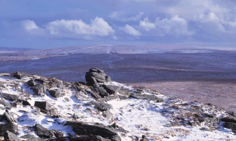 Rock formations on a snow covered landscape, Yes Tor, Dartmoor, Devon, England.