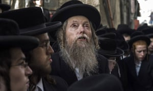 Ultra orthodox relatives and friends attend the funeral of Yesheayahu Krishevsky.