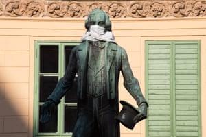 Vienna, Austria A statue of Johann Nestroy wears a mask in Vienna