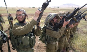 Israeli soldiers of an ultra-Orthodox battalion take part in annual training in the Golan Heights, near the Syrian border.