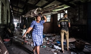 Squatters remove all their belongings from the part of the railway shed they had called home for several years.