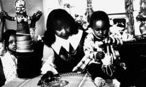 Winnie Mandela with two of her grandchildren in her home in Soweto, 1985